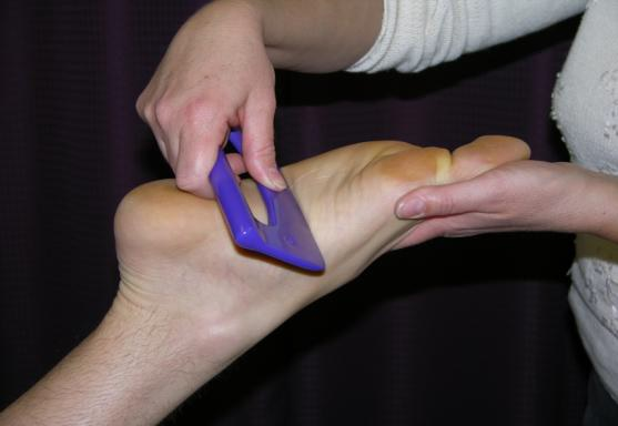 SASTM method being used on foot